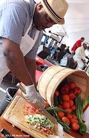 picture of chef chopping tomatoes